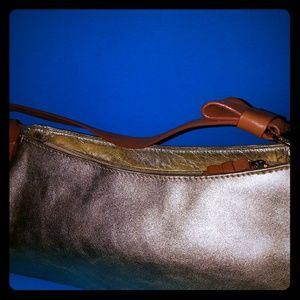 Gold and tan genuine leather leather BCBGirls bag